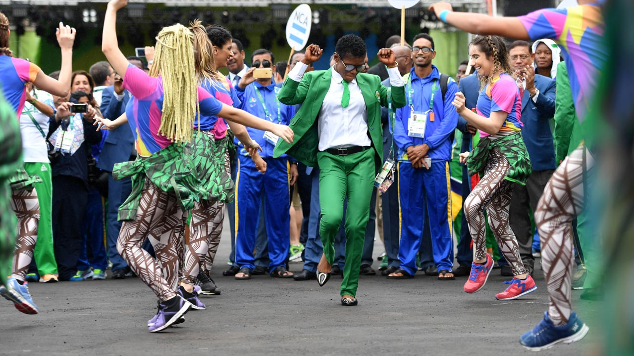 Nigerian athletes join dancers performing during a welcoming ceremony for Nigeria's Olympic team at the Athletes' Village ahead of the Rio 2016 Olympic Games in Rio de Janeiro on August 3, 2016. Andrej ISAKOVIC / AFP