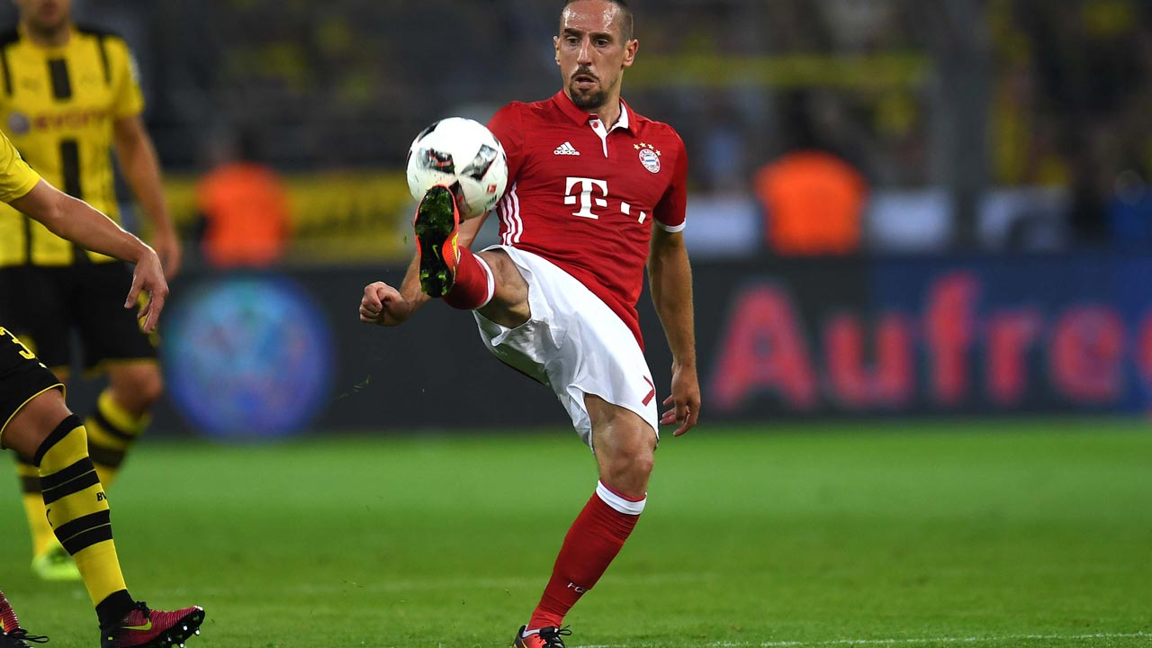 Bayern Munich's French midfielder Franck Ribery vies for the ball during the German Super Cup football match final Borussia Dortmund vs FC Bayern Munich in Dortmund on August 14, 2016. PHOTO: PATRIK STOLLARZ / AFP