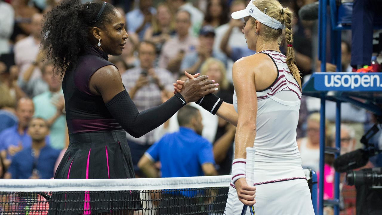 Serena Williams of the US and Ekaterina Makarova of Russia meet at the net after their 2016 US Open Women's Singles match at the USTA Billie Jean King National Tennis Center on August 30, 2016 in New York. Don EMMERT / AFP