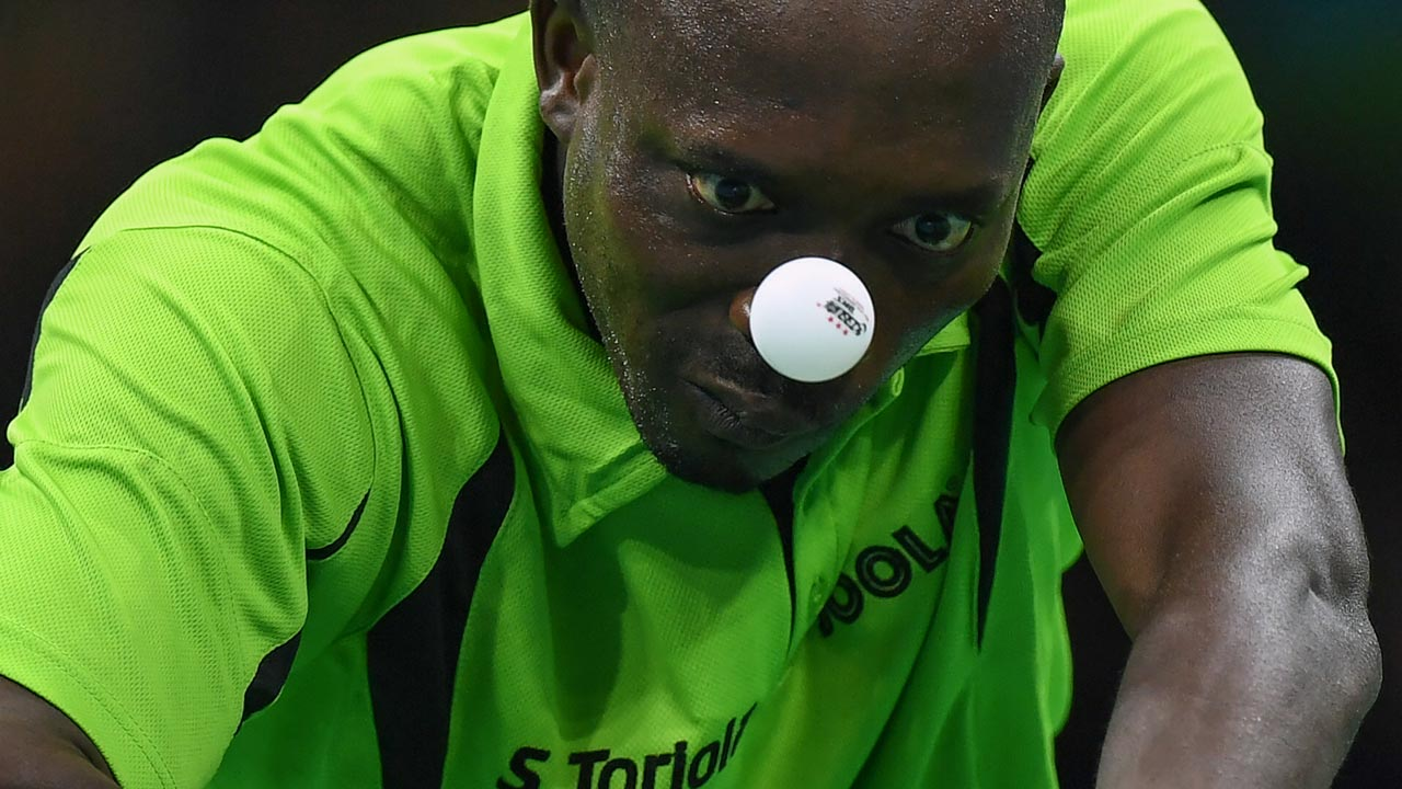 Nigeria's Segun Toriola eyes the ball in his men's singles qualification round table tennis match at the Riocentro venue during the Rio 2016 Olympic Games in Rio de Janeiro on August 7, 2016. Jim WATSON / AFP