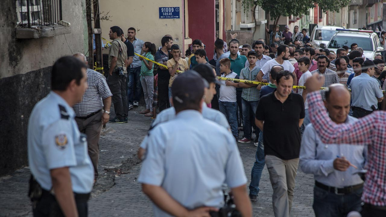 "People watch the explosion scene on August 21, 2016 in Gaziantep in southeastern Turkey near the Syrian border following a late night attack on a wedding party that left at least 30 dead. Turkish President Recep Tayyip Erdogan on Sunday said the Islamic State (IS) group was the ""likely erpetrator"" of the bomb attack. rdogan said in a written statement that there was ""no difference"" between the group of US-based preacher Fethullah Gulen who he blames for a failed July 15 coup bid, the outlawed Kurdistan Workers Party (PKK) ""and Daesh (IS), the likely perpetrator of the attack in Gaziantep"". PHOTO: AHMED DEEP / AFP"
