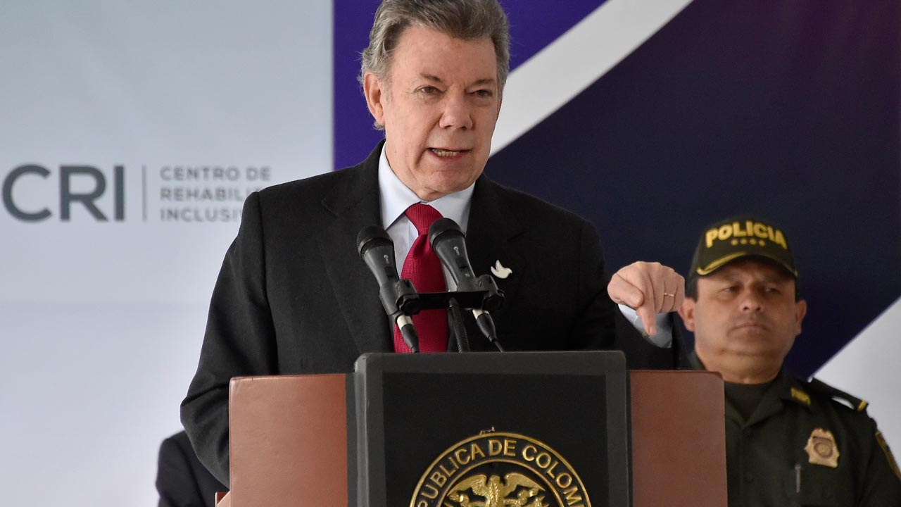 Colombian President Juan Manuel Santos delivers a speech during the opening of the Center for Integral Rehabilitation for soldiers and police officers victims of armed conflict, in Bogota, Colombia on August 29, 2016. Colombia began its first day of peace with the country's largest insurgency after a ceasefire between the FARC and the government went into effect, ending 52 years of warfare. GUILLERMO LEGARIA / AFP