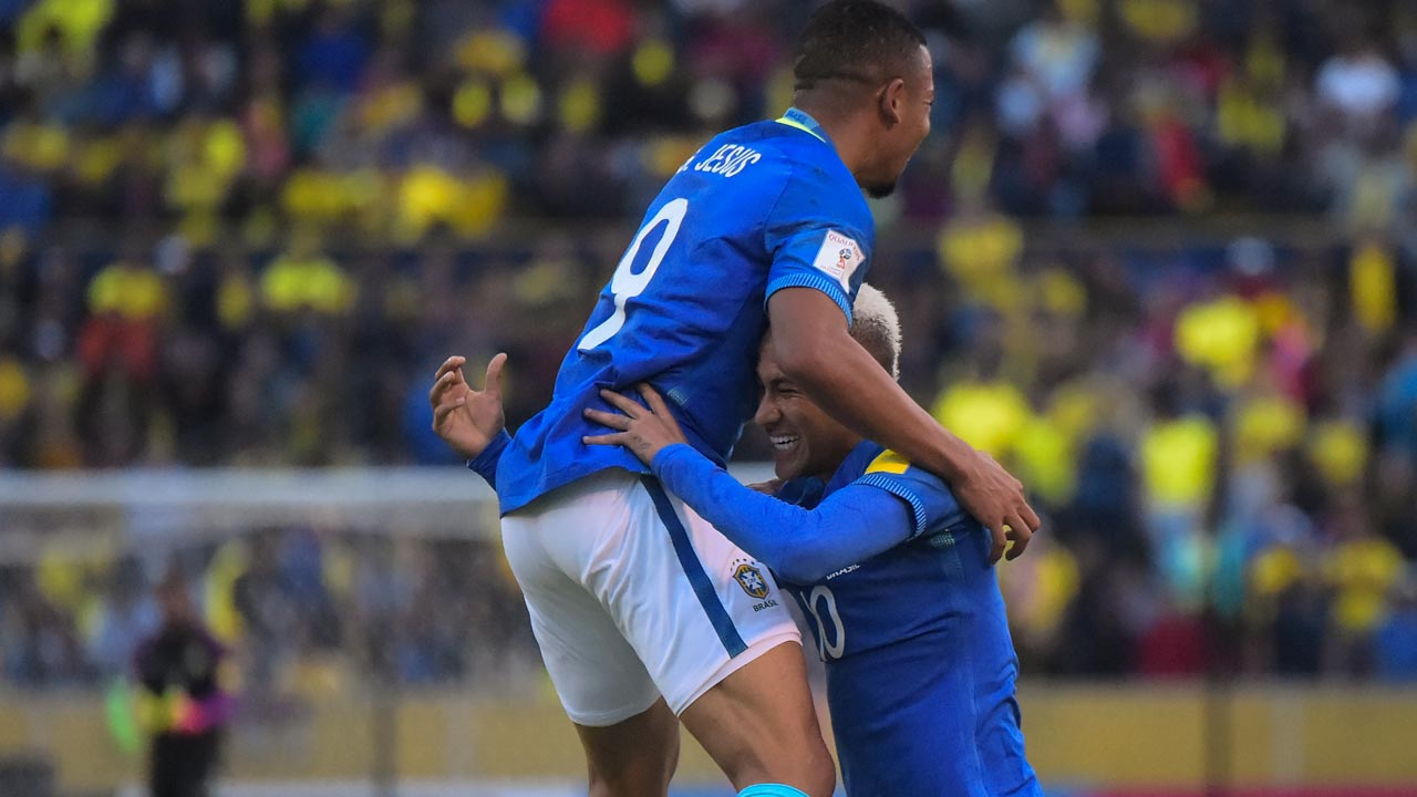 Brazil's Gabriel Jesus (L) celebrates with Neymar Jr after winning their 2018 FIFA World Cup qualifying football match between Ecuador and Brazil at the Atahualpa stadium in Quito, on September 1, 2016. RODRIGO BUENDIA / AFP