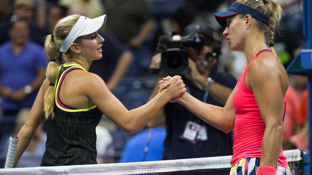 Catherine Bellis of the US (L) and Angelique Kerber of Germany meet at the net after their 2016 US Open women's singles match at the USTA Billie Jean King National Tennis Center on September 2, 2016 in New York. Don EMMERT / AFP