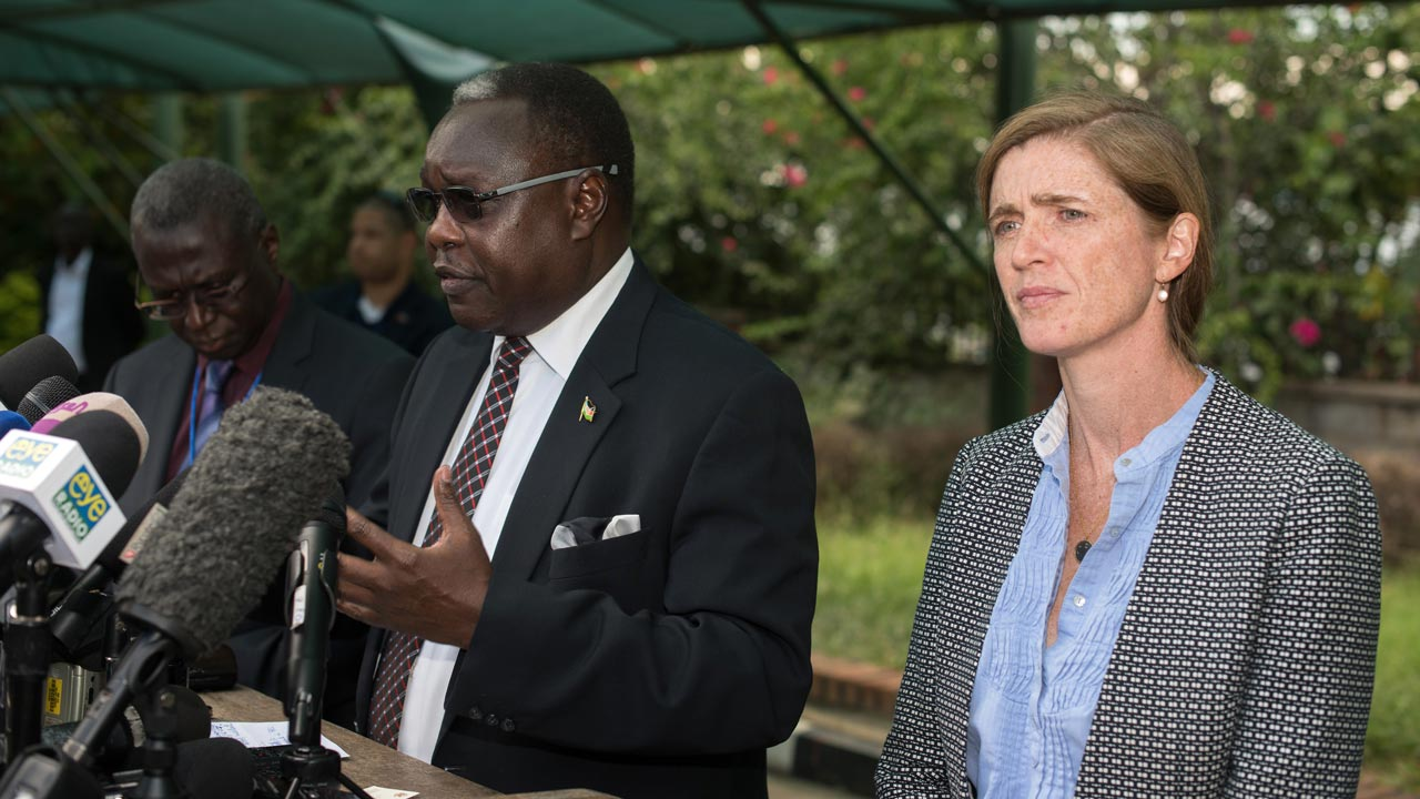 South Sudan's Cabinet Affairs Minister Martin Elia Lomoro (L), flanked by US Ambassador to the United Nations Samantha Power, delivers a speech in Juba on September 3, 2016. A UN Security Council delegation meets representatives from South Sudanese civil society on September 3, 2016, as part of a two-day visit aimed at persuading President Salva Kiir to accept the deployment of a regional force.