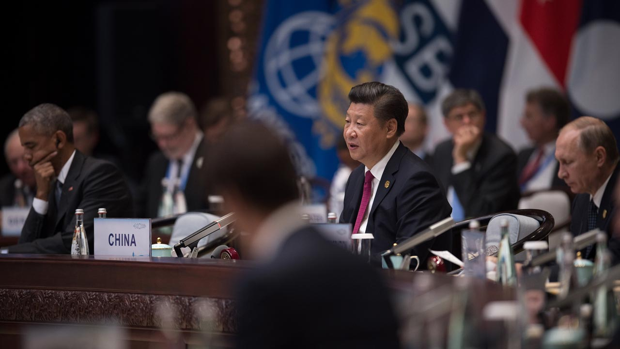Chinese President Xi Jinping (C) gives a speech during the opening ceremony of the G20 Leaders Summit whilst US President Barack Obama (L) and Russia's President Vladimir Putin (R) listen in Hangzhou on September 4, 2016. G20 leaders confront a sluggish global economy and the winds of populism as they open annual talks, but the long war in Syria and the South China Sea territorial dispute hang over the summit. NICOLAS ASFOURI / POOL / AFP