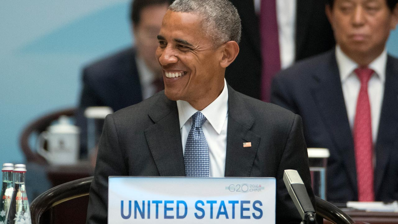 US President Barack Obama smiles during the opening ceremony of the G20 Summit in Hangzhou on September 4, 2016. G20 leaders confront a sluggish global economy and the winds of populism as they open annual talks, but the long war in Syria and the South China Sea territorial dispute hang over the summit. Mark Schiefelbein / POOL / AFP