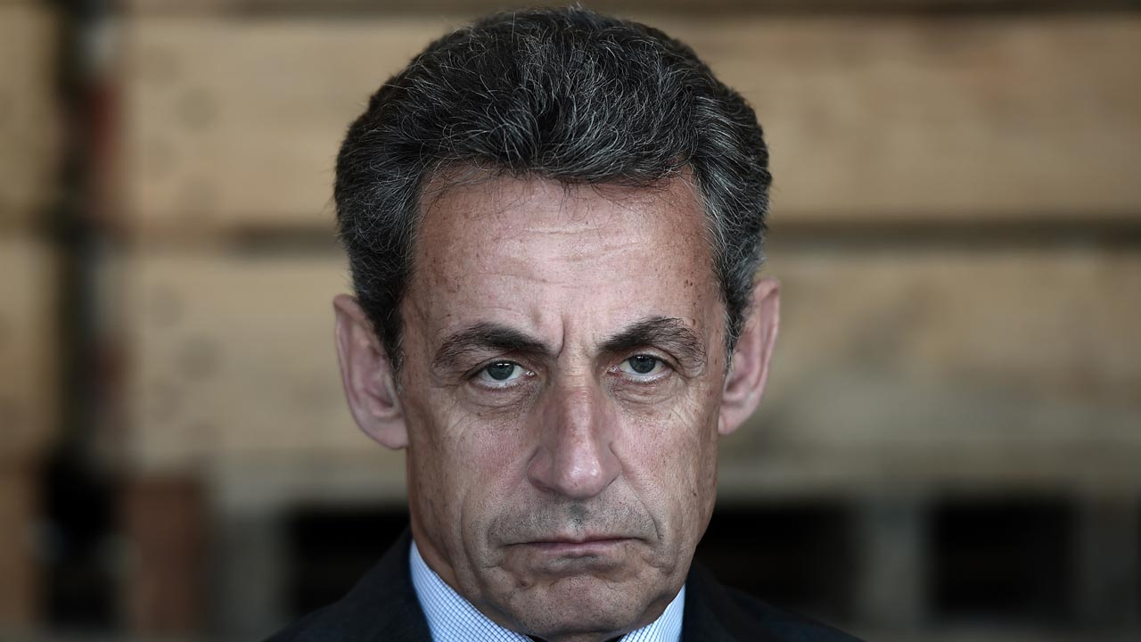 "(FILES) This file photo taken on July 9, 2016 shows Former French president and head of the right-wing opposition party ""Les Republicains"" (The Republicans) Nicolas Sarkozy looking on during a meeting with farmers in Kriegsheim, eastern France. Former French president Nicolas Sarkozy, who is making a fresh bid for election next year, could face trial over alleged illegal funding of his failed 2012 campaign, a source in the investigation said on September 5, 2016. ""Prosecutors are calling for all of those charged to be tried,"" the source told AFP. An investigating magistrate must now decide whether to follow the prosecution's recommendations. PHOTO: FREDERICK FLORIN / AFP"