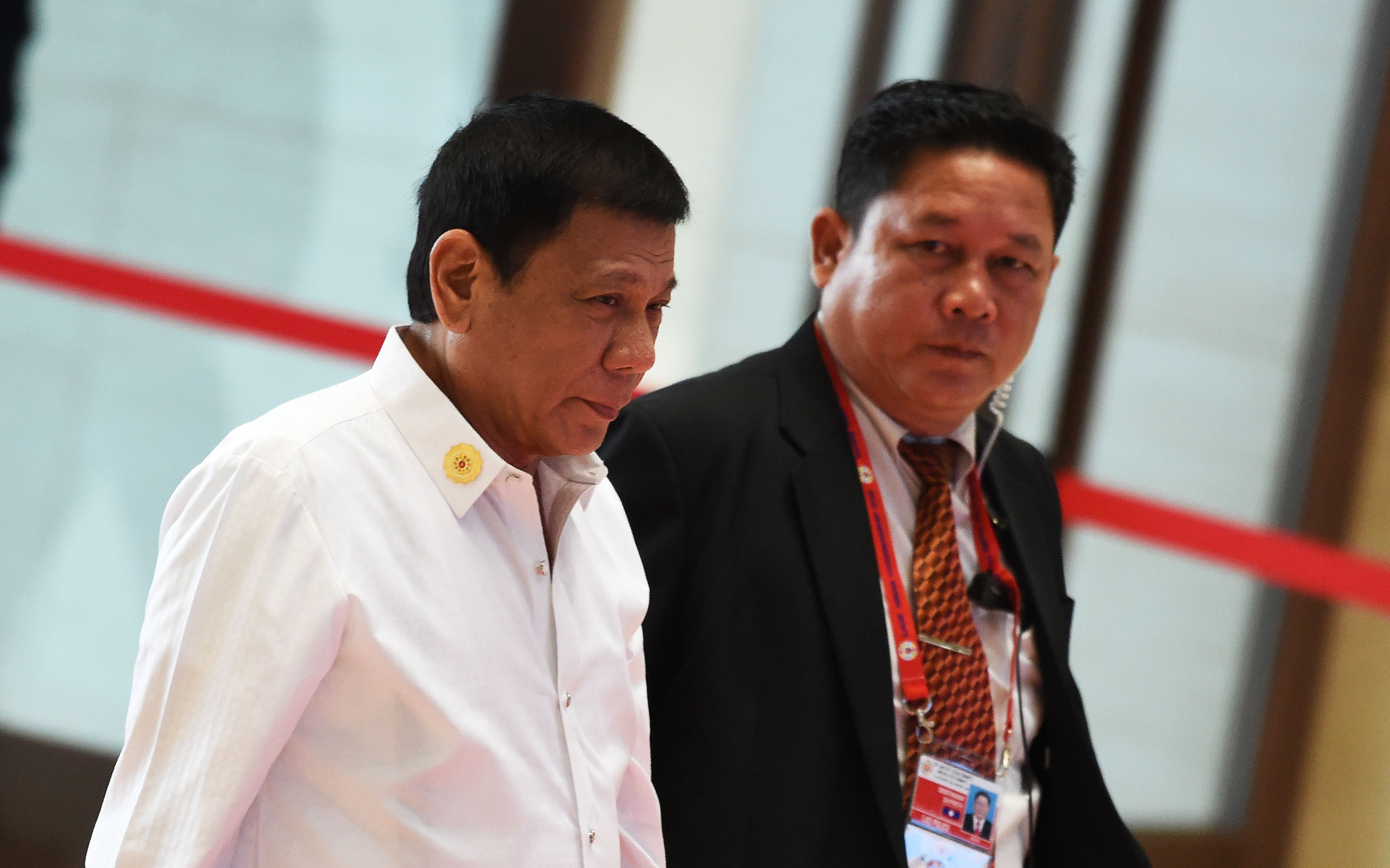 "Philippine President Rodrigo Duterte (L) arrives at the convention centre to attend the 28th and 29th Association of Southeast Asian Nations (ASEAN)in Vientiane on September 6, 2016. Duterte expressed regret for a tirade against Barack Obama in which he called the US leader a ""son of a whore"". / AFP PHOTO / ROSLAN RAHMAN"