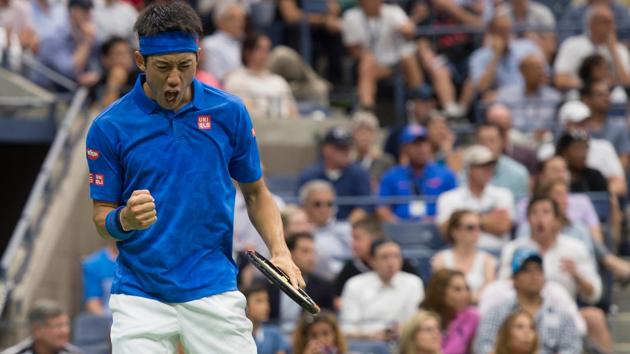 Kei Nishikori of Japan reacts to a point against Andy Murray of Great Britain during their 2016 US Open men's singles quarterfinals match at the USTA Billie Jean King National Tennis Center on September 7, 2016 in New York. Kei Nishikori stunned Andy Murray to reach the US Open semi-finals, holding his nerve in a breathtaking final set to move two wins away from becoming the first Asian man to capture a Grand Slam singles title. Don EMMERT / AFP