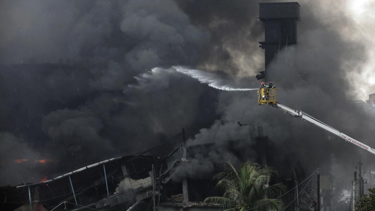 Bangladeshi firefighters work to put out a huge fire at the site of an explosion in a factory in the key Bangladeshi garment manufacturing town of Tongi, just north of the capital Dhaka, on September 10, 2016. At least fifteen people have been killed and 70 injured, many critically, in a huge fire triggered by a boiler explosion at a Bangladeshi packaging factory, officials said on September 10. Rajib Dhar / AFP