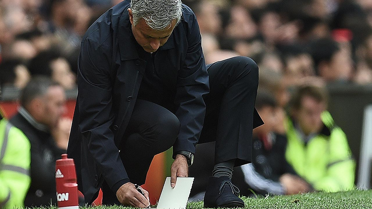 Manchester United's Portuguese manager Jose Mourinho makes notes on the touchline during the English Premier League football match between Manchester United and Manchester City at Old Trafford in Manchester, north west England, on September 10, 2016. Oli SCARFF / AFP