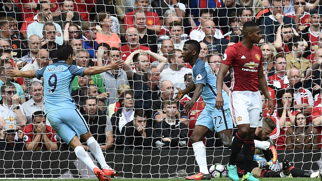 Manchester City's Nigerian striker Kelechi Iheanacho (2nd L) celebrates after scoring their second goal during the English Premier League football match between Manchester United and Manchester City at Old Trafford in Manchester, north west England, on September 10, 2016. Oli SCARFF / AFP