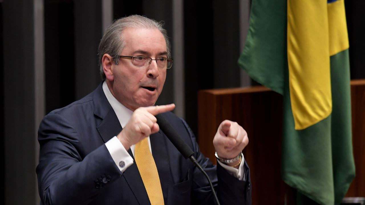 The former president of Brazil's lower house Eduardo Cunha delivers a speech during a session in the Chamber of Deputies that will decide whether or not to impeach him, in Brasilia on September 12, 2016. PHOTO: EVARISTO SA / AFP