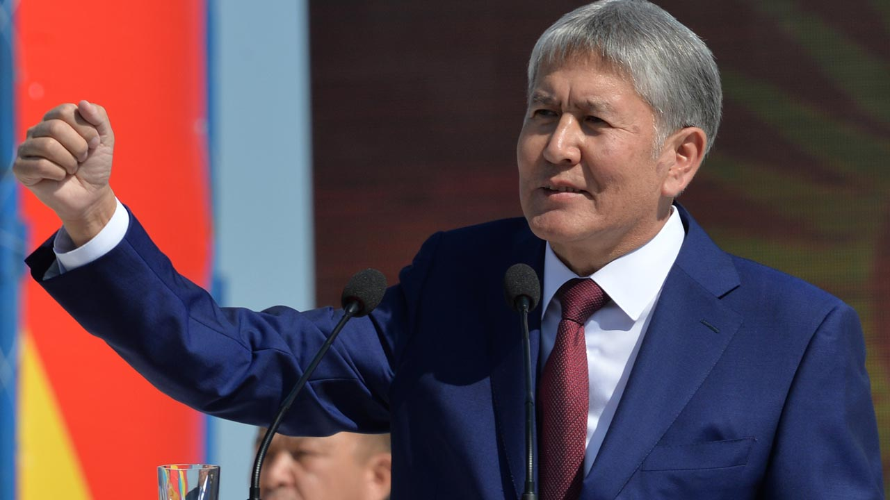 (FILES) This file photo taken on August 31, 2016 shows Kyrgyz Prezident Almazbek Atambayev gesturing as he attends celebrations marking the 25th anniversary of Kyrgyzstan's independence from the Soviet Union at the Ala-Too Square in Bishkek. Kyrgyz President Almazbek Atambayev was forced to abort a trip to the UN General Assembly after being taken ill with heart problems, his office said on September 19, 2016. Atambayev, who celebrated his 60th birthday on Saturday, has headed the impoverished Central Asian nation since winning a presidential election in 2011. Vyacheslav OSELEDKO / AFP