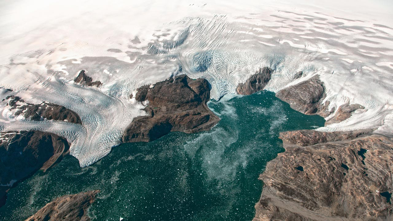 This NASA Earth Observatory image obtained September 22, 2016 show some glaciers observed from the HU-25A Guardian aircraft on September 2, 2016, showing the Brückner and Heim glaciers where they flow into Johan Petersen Fjord in southeastern Greenland. Greenland's highly unstable ice sheet is melting more than seven percent faster than previously thought, scientists said this week after discovering a hotspot beneath the Earth's crust that was distorting their calculations. The study in the journal Science Advances raises concern about the increasing impact of melting ice on sea level rise, since Greenland is the second largest ice sheet in the world after the one in Antarctica. PHOTO: Jeremy HARBECK / NASA Goddard / AFP