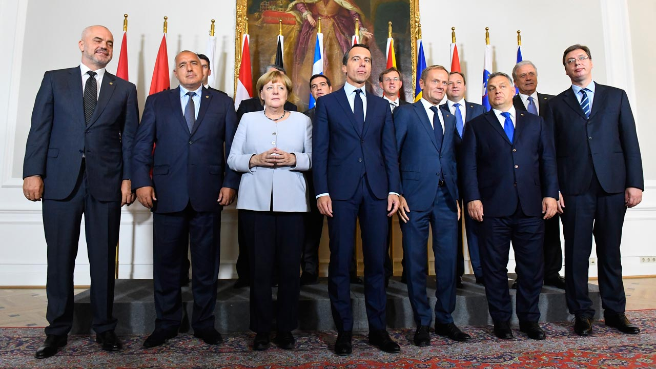 Back row, L to R) Romania's Foreign Minister Dragos Tudorache, Croatian Prime Minister Tihomir Oreskovic, Greece's Prime Minister Alexis Tsipras, Slovenian Prime Minister Miro Cerar, Macedonian Prime Minister Emil Dimitriev and EU commissioner Dimitris Avramopoulos, (front row, L to R) Albania's Prime Minister Edi Rama, Bulgaria's Prime minister Boyko Borissov, German chancellor Angela Merkel, Austrian chancellor Christian Kern, European Council President Donald Tusk, Hungarian Prime Minister Viktor Orban and Serbia's prime minister Aleksandar Vucic Aleksandar Vucic pose for a family photo after a meeting on the Balkan migrant route into the EU in Vienna on September 24, 2016. JOE KLAMAR / AFP