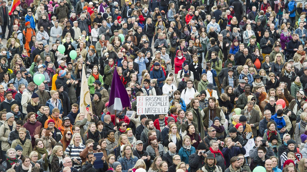 People demonstrate against racism and fascism in Helsinki, Finland on September 24, 2016 after a counter protester died on a farright demonstration. Around 15,000 people marched in central Helsinki to protest against rising racism and violent right-wing extremism, police said, following the recent death of a man allegedly attacked by a neo-Nazi leader. Jarno Mela / Lehtikuva / AFP
