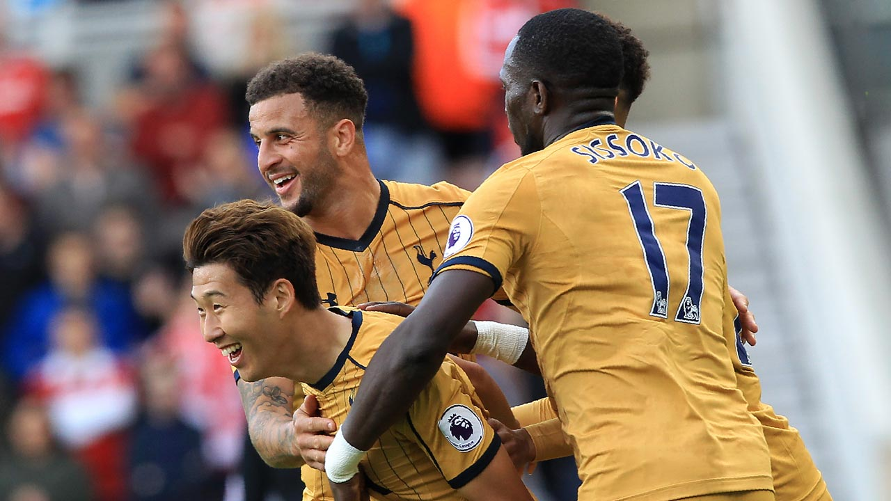 Tottenham Hotspur's South Korean striker Son Heung-Min (L) celebrates scoring his team's first goal during the English Premier League football match between Middlesbrough and Tottenham Hotspur at Riverside Stadium in Middlesbrough, northeast England on September 24, 2016. GEOFF CADDICK / AFP