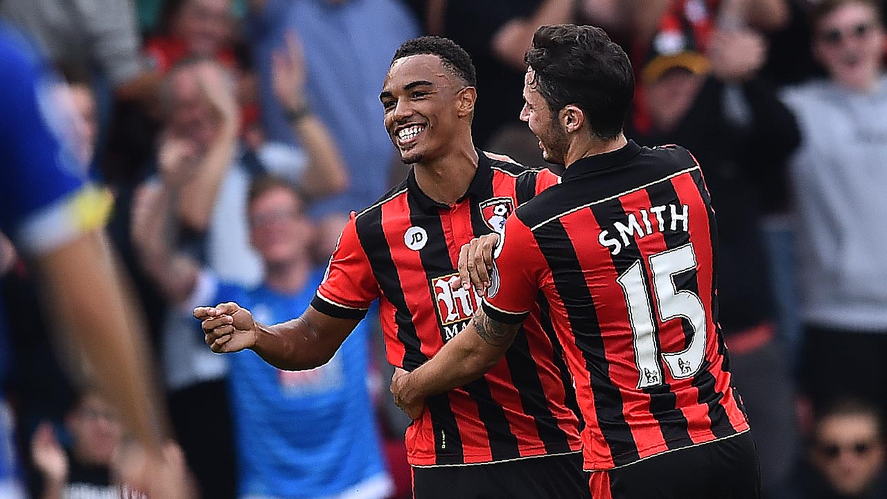 Bournemouth's English midfielder Junior Stanislas (L) celebrates with Bournemouth's English defender Adam Smith after scoring his team's first goal during the English Premier League football match between Bournemouth and Everton at the Vitality Stadium in Bournemouth, southern England on September 24, 2016. Glyn KIRK / AFP