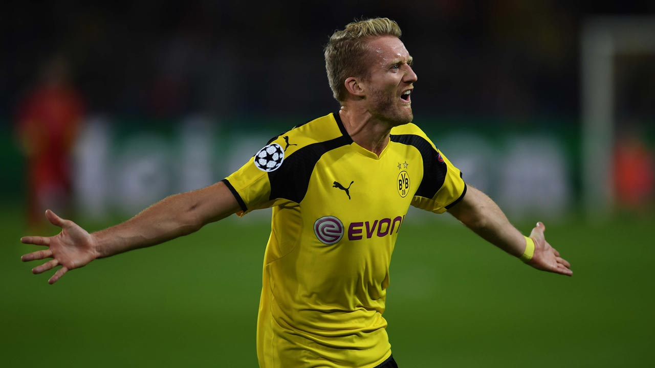 Dortmund's midfielder Andre Schuerrle reacts after scoring during the UEFA Champions League first leg football match between Borussia Dortmund and Real Madrid at BVB stadium in Dortmund, on September 27, 2016. PATRIK STOLLARZ / AFP