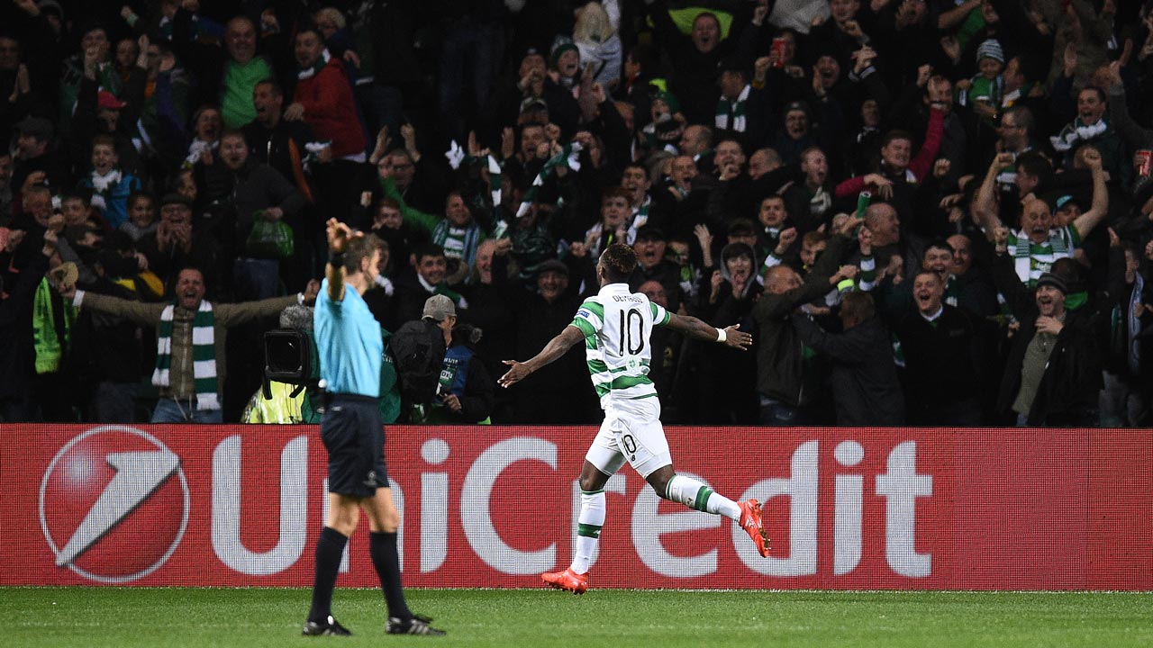 Celtic's French striker Moussa Dembele celebrates scoring his team's third goal during the UEFA Champions League Group C football match between Celtic and Manchester City at Celtic Park stadium in Glasgow, Scotland on September 28, 2016. OLI SCARFF / AFP