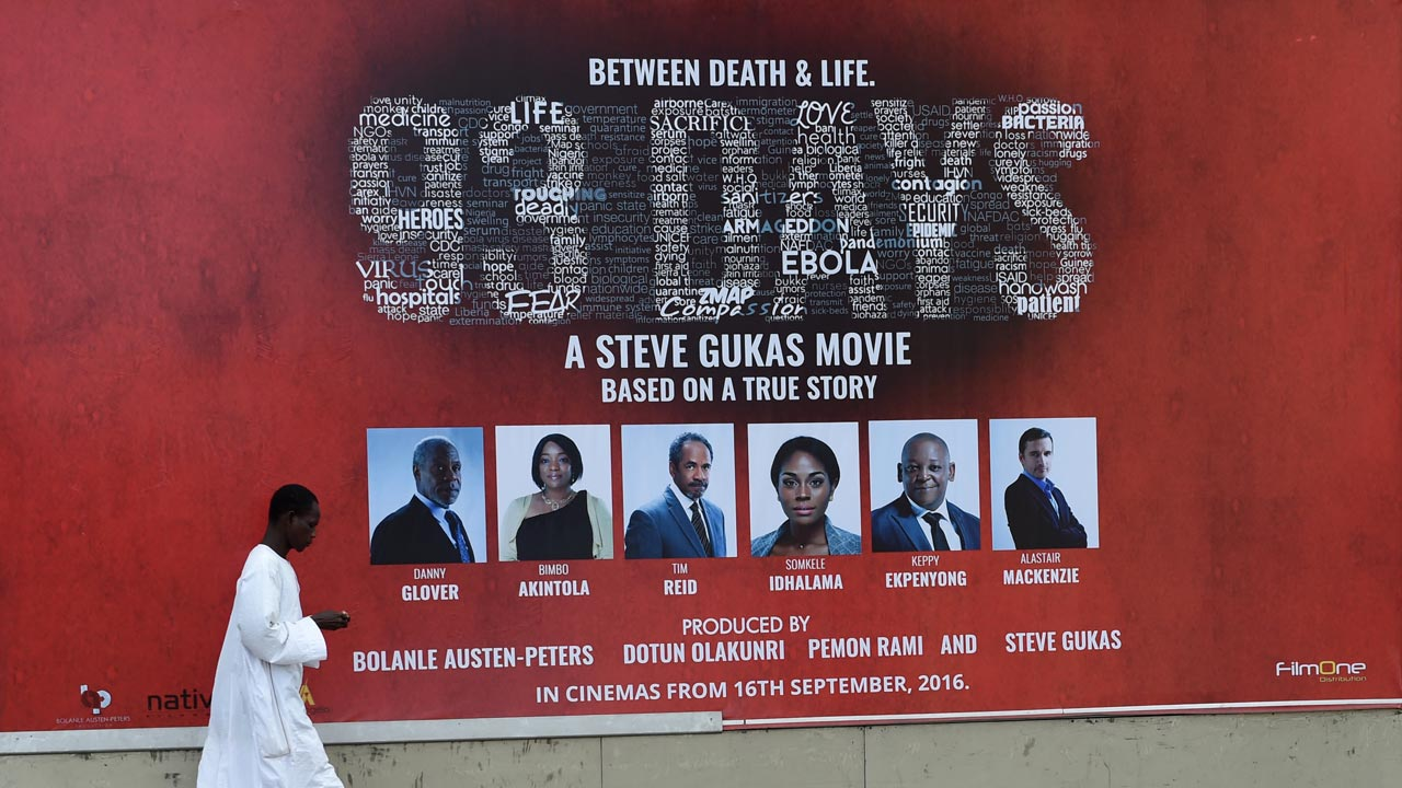 "A billboard promoting the premier of Nollywood film ""93 Days"" in Lagos, on September 9, 2016. Hollywood plague movies are usually about a fictional viral outbreak, unleashing chaos and anarchy that can only be stopped by heroes who transcend the panic. That's not true for ""93 Days"", a Nollywood film premiering on September 13, 2016, which dramatises the story of Nigeria's response to the very real Ebola epidemic in 2014 that killed more than 11,000 people in West Africa. PHOTO: PIUS UTOMI EKPEI / AFP"