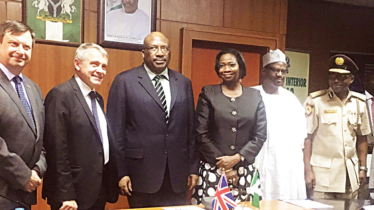 British High Commissioner to Nigeria, Paul Awkright (left); UK Immigration Minister, Robert Goodwill; Minister of Interior, Abdurahman Dambazzau; SSA to the President on Foreign Affairs and Diaspora, Abike Dabiri Erewa; Acting Permanent Secretary, Ministry of Interior, Mohammed Maccido; and CG Immigration, Mohammed Babadede, during signing of an MoU between the UK and Nigeria on immigration at the Ministry of Interior, Abuja