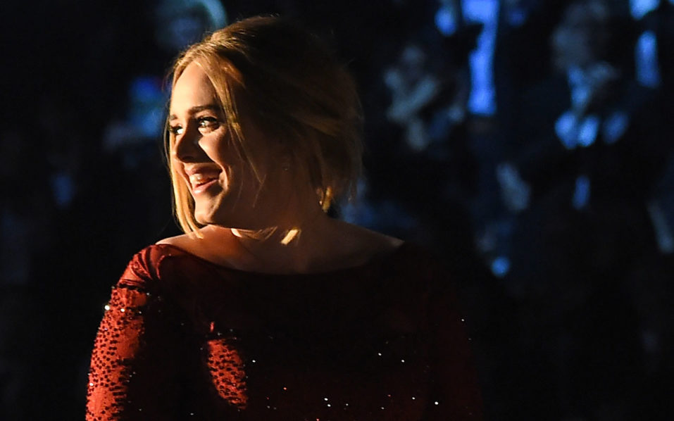 "(FILES) This file photo taken on February 15, 2016 shows singer Adele performing onstage during the 58th Annual Grammy Awards in Los Angeles, California. Adele's ""25"" has topped 10 million sales in the United States, her second album to cross the threshold as the English singer cements her status as the century's top-selling artist. The US industry body presented Adele a plaque certifying that ""25,"" released in November, had gone diamond platinum, or sold 10 million, at a ceremony backstage at New York's Madison Square Garden where she just played six sold-out shows, her publicist announced September 27, 2016.  / AFP PHOTO / ROBYN BECK"