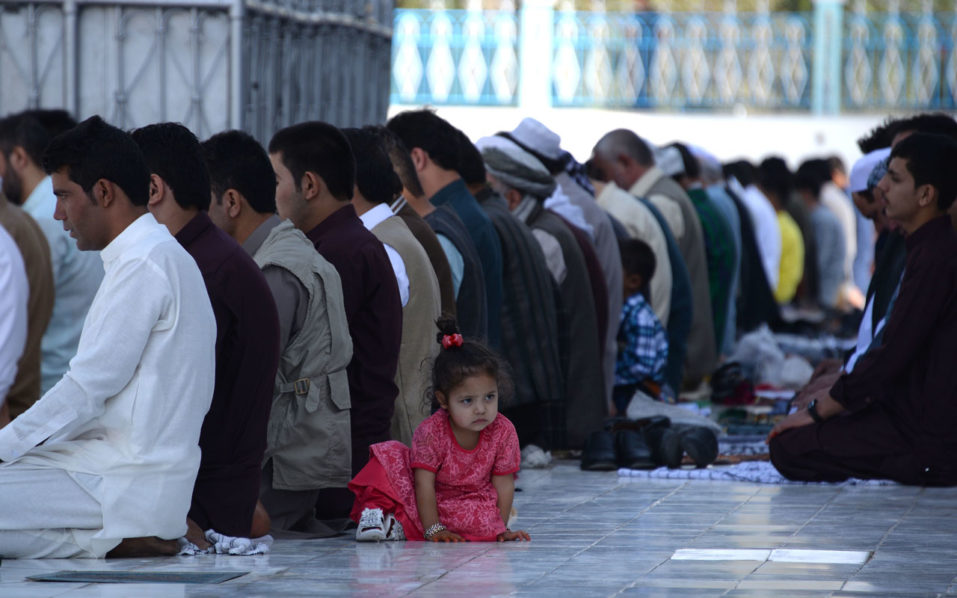 "Afghan Muslims offer Eid-al-Adha prayers at the Hazrat-i- Ali shrine in Mazar-i Sharif on September 12, 2016. Afghans started celebrating Eid al-Adha or ""Feast of the Sacrifice"", which marks the end of the annual hajj or pilgrimage to Mecca and is celebrated in remembrance of Abraham's readiness to sacrifice his son to God. / AFP PHOTO / FARSHAD USYAN"