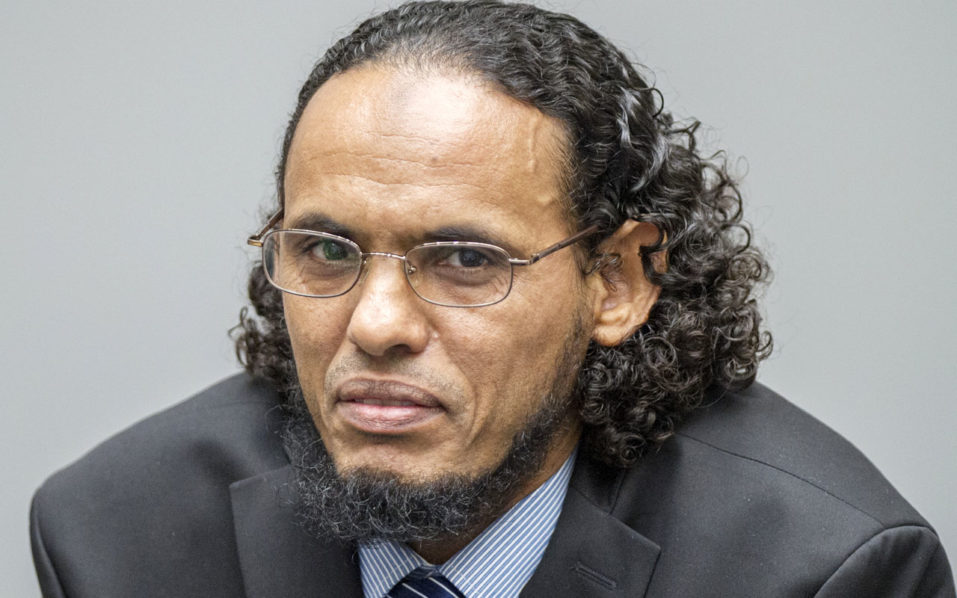 (FILES) This file photo taken on August 22, 2016 shows alleged Al-Qaeda-linked Islamist leader Ahmad Al Faqi Al Mahdi looking on during an appearance at the International Criminal Court in The Hague, at the start of his trial on charges of involvement in the destruction of historic mausoleums in the Malian desert city of Timbuktu. On September 27, 2016, Ahmad Al-Faqi Al-Mahdi will be sentenced on war crimes charges at The Hague for his role in the destruction of nine of Timbuktu's holy shrines as well as the door of a revered mosque in 2012.   / AFP PHOTO / ANP / Patrick POST
