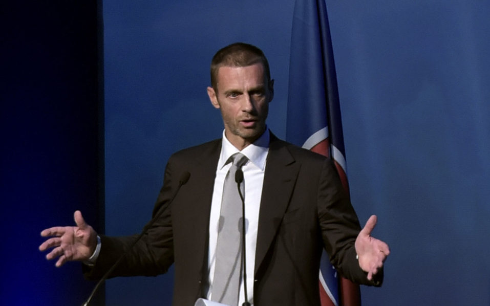 UEFA's newly elected president, Slovenian Aleksander Ceferin, delivers a speech following the vote during the 12th Extraordinary UEFA congress in Lagonissi, some 40 kilometers south of Athens, on September 14, 2016. Disgraced football leader Michel Platini said on September 14 in a farewell speech to UEFA that he felt no guilt over a $2 million payment from FIFA that has seen him suspended for four years. / AFP PHOTO / ARIS MESSINIS