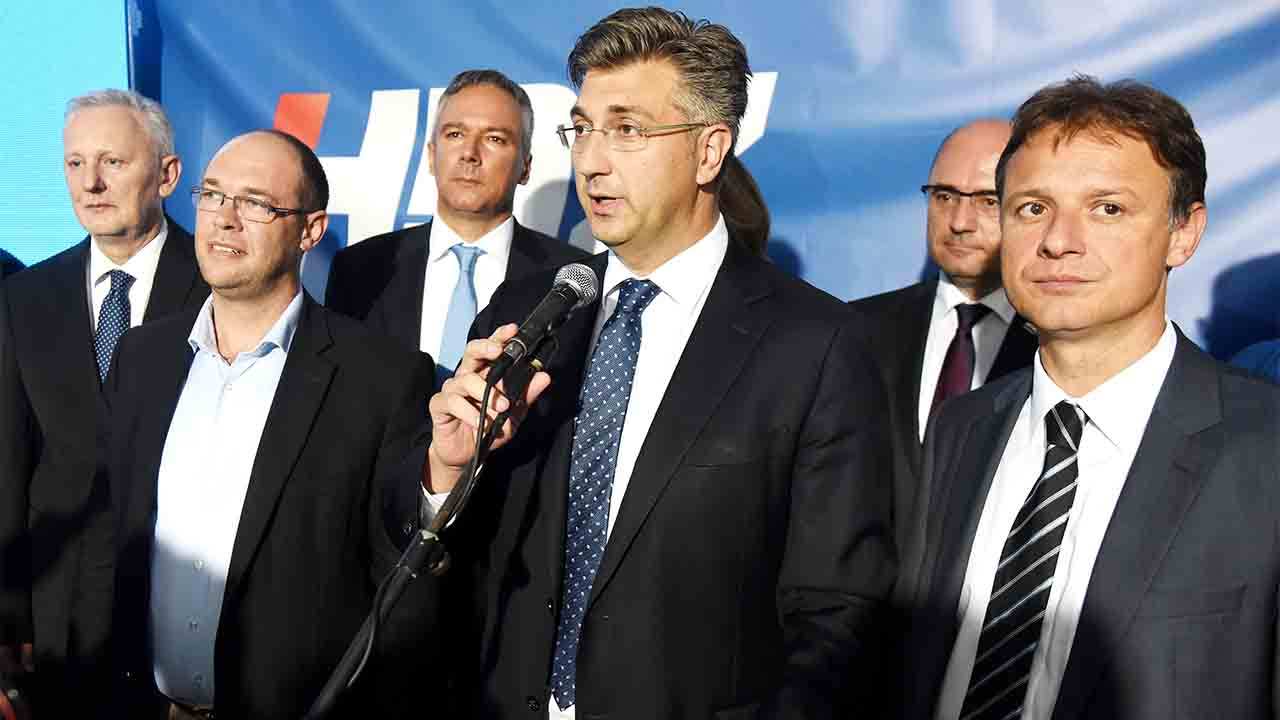 Andrej Plenkovic (C), leader of the Croatian Democratic Union party (HDZ), delivers a speech after the party's parliamentary election victory at the headquarters of HDZ in Zagreb, Croatia, on September  11, 2016. / AFP PHOTO / STR