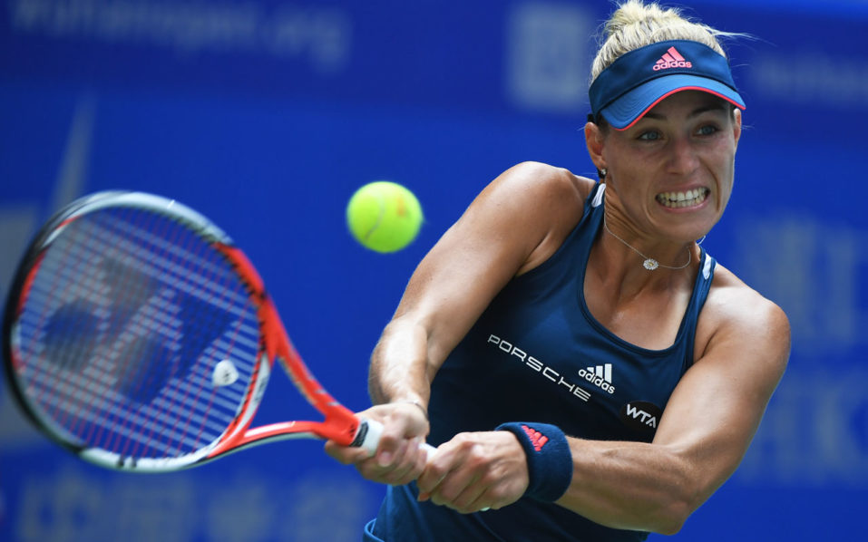 Angelique Kerber of Germany hits a return during her second round match against Kristina Mladenovic of France at the WTA Wuhan Open in Wuhan, in China's central Hubei province on September 27, 2016. / AFP PHOTO / GREG BAKER