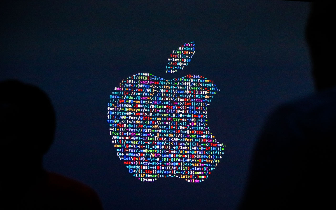 (FILES) This file photo taken on June 13, 2016 shows the Apple logo displayed on a screen at Apple's annual Worldwide Developers Conference presentation at the Bill Graham Civic Auditorium in San Francisco, California. Apple logo/ AFP PHOTO / GABRIELLE LURIE