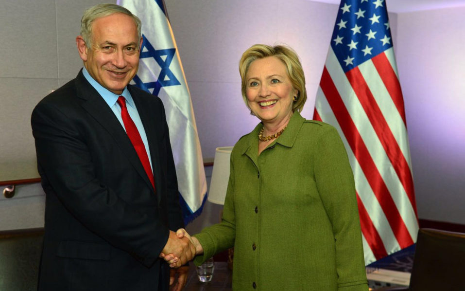 A handout picture obtained from the Israeli Government Press Office (GPO) shows Democratic President candidate Hillary Clinton (R) shaking hands with Israel Prime Minister Benjamin Netanyahu after a meeting at the W Hotel on Union Square September 25, 2016 in New York, New York. / AFP PHOTO / GPO / Kobi GIDEON /