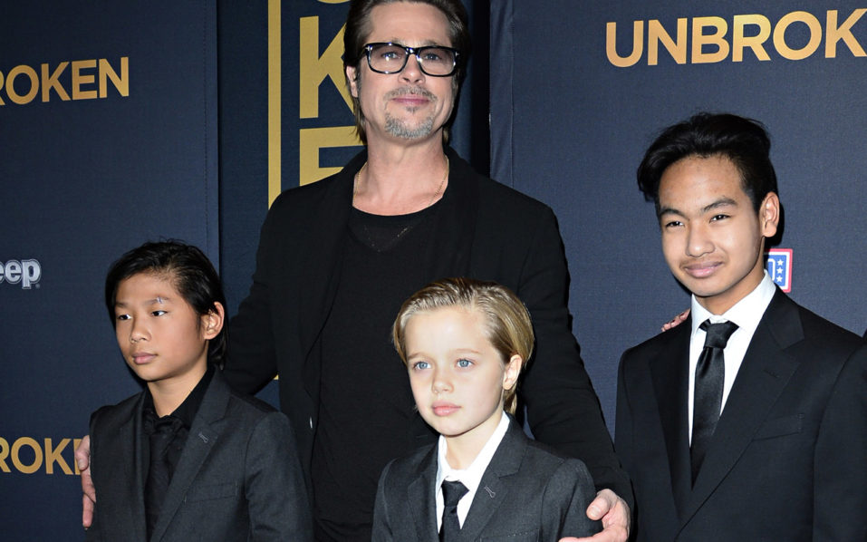 "(FILES) This file photo taken on December 15, 2014 shows actor Brad Pitt and children Pax Jolie-Pitt (L), Shiloh Jolie-Pitt (C) and Maddox Jolie-Pitt as they arrive for the US premiere of Universal Pictures ""Unbroken,""  at the Dolby Theatre in Hollywood, California.   Brad Pitt is under investigation by US authorities after being accused of physically and verbally abusing his children during an angry outburst, TMZ reported September 22, 2016. According to the entertainment news site the Los Angeles Police Department began probing Pitt based on an anonymous tip received by the LA County Department of Children and Family Services, as is systematic following any report of child abuse.  / AFP PHOTO / ROBYN BECK"