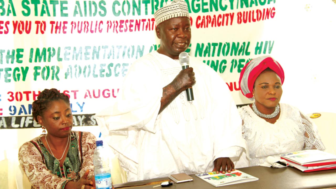 Assistant Director, National Agency for the Control of AIDS (NACA), Dr. Uduak Daniel (left); Permanent Secretary Taraba State Ministry of Health (TSMoH), Imam Ibrahim; and Commissioner MOWCD, Mrs. Louis Emmanuel at the Taraba State Dissemination and Capacity Building Workshop on the Implementation of the National HIV Strategy for Adolescents and Young People