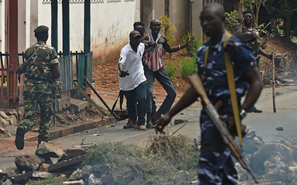 "(FILES) This file photo taken on May 20, 2015 shows a protestor opposed to the Burundian President's third term arrested during a demonstration in the Cibitoke neighborhood of Bujumbura.  Burundi's government is behind systematic human rights violations, including executions and torture, UN investigators said on September 20, 2016, warning of possible crimes against humanity and the looming risk of ""genocide"".  / AFP PHOTO / CARL DE SOUZA"