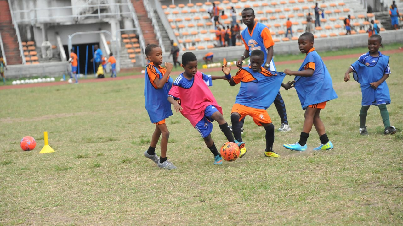 The young shall grow… Holidaying children displaying their talents during the final of the Cowbell Football Academy's (CFA) camp in Lagos…recently.