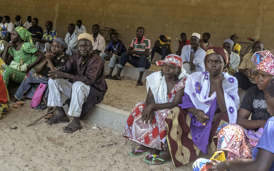 Cameroonian displaced people wait for food parcels at a food distribution center in Koza, in the extreme northern province, west of the Nigerian border  / AFP PHOTO / REINNIER KAZE
