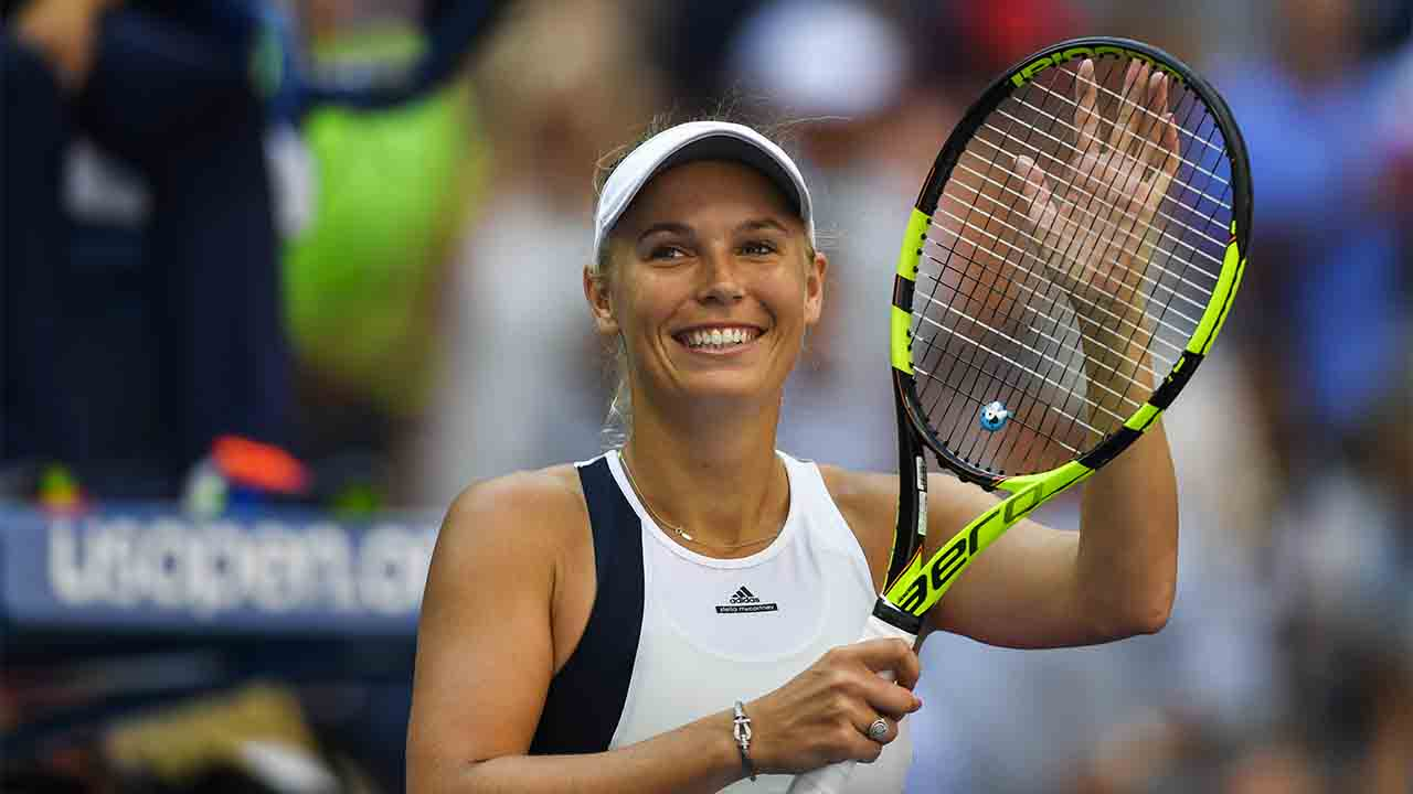 Caroline Wozniacki of Denmark celebrates after defeating Madison Keys of United States during their 2016 US Open Women's Singles match at the USTA Billie Jean King National Tennis Center in New York on September 4, 2016. / AFP PHOTO / EDUARDO MUNOZ ALVAREZ