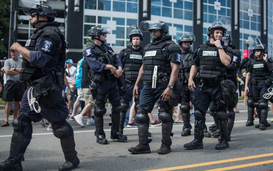 Police in riot gear walk outside Bank of America Stadium before an NFL football game between the Charlotte Panthers and the Minnesota Vikings September 25, 2016 in Charlotte, North Carolina.. Protests have disrupted the city since Tuesday night following the shooting of 43-year-old Keith Lamont Scott at an apartment complex near UNC Charlotte.   Sean Rayford/Getty Images/AFP
