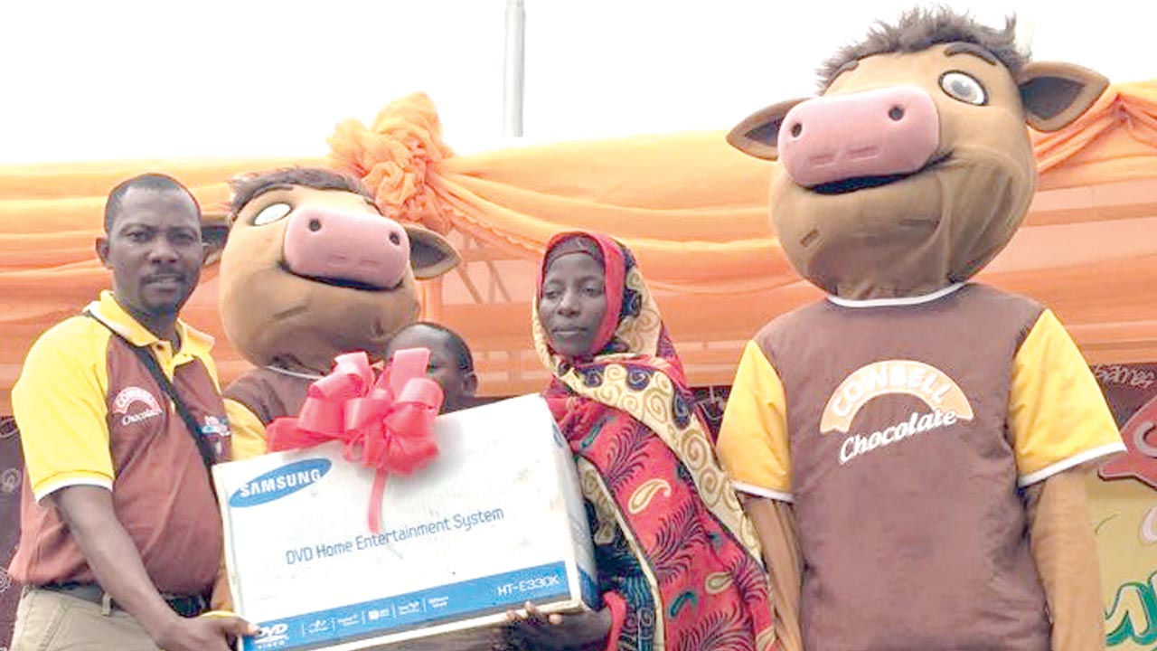 Sulyman Sony, prize winner of a mini home theatre receives his gift at the Chocademy funfair in Ilorin.