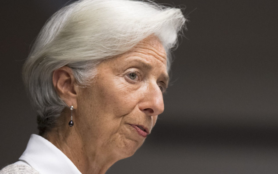 (FILES) This file photo taken on July 14, 2016 in Washington, DC, shows International Monetary Fund Managing Director Christine Lagarde speaking at the Center for Global Development marking the 15th anniversary of the Center. Lagarde will go on trial in France on December 12 over a massive state payout to tycoon Bernard Tapie made when she was finance minister, the court hearing the case said on September 12, 2016. / AFP PHOTO / JIM WATSON