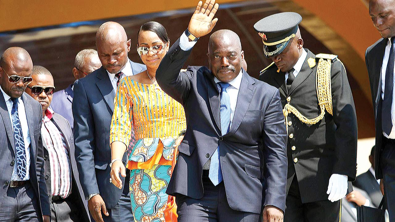 President Joseph Kabila (waving) and other members of his cabinet at an event in DRC. PHOTO: AFP