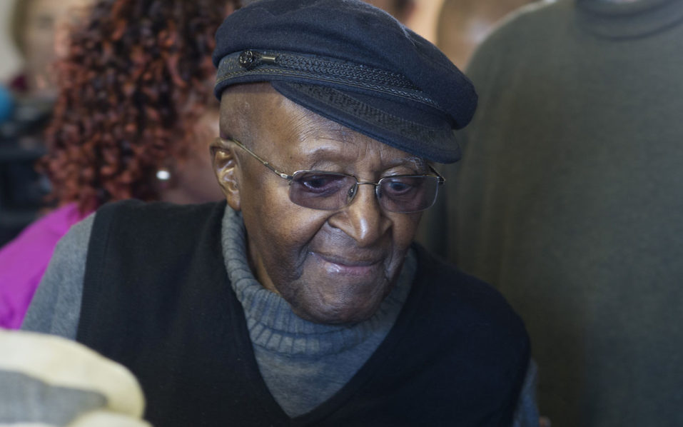 """(FILES) This file photo taken on August 3, 2016 shows South African anti-apartheid activist and Nobel Peace Laureate Archbishop Desmond Tutu arriving to cast his vote in the South African local government elections at Milnerton High School in Cape Town. South Africa's retired archbishop Desmond Tutu was on Wednesday discharged from hospital after spending three weeks receiving treatment for a """"recurring infection"""", his family said. Tutu had been admitted to a Cape Town hospital and last week underwent a """"minor surgical procedure"""" to determine the cause of the infection.  / AFP PHOTO / RODGER BOSCH"""