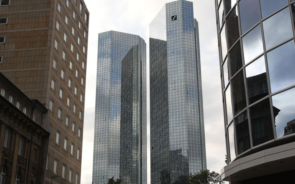 "The headquarters of German company Deutsche Bank is pictured in Frankfurt, Germany, on September 26, 2016, after shares in Deutsche Bank, Germany's biggest lender, hit a record low. Shares in Deutsche Bank, Germany's biggest lender, hit a record low on Monday after reports at the weekend that Berlin had refused state aid for the embattled lender. / AFP PHOTO / DANIEL ROLAND / ""The erroneous mention[s] appearing in the metadata of this photo by DANIEL ROLAND has been modified in AFP systems in the following manner: [---] instead of [---]. Please immediately remove the erroneous mention[s] from all your online services and delete it (them) from your servers. If you have been authorized by AFP to distribute it (them) to third parties, please ensure that the same actions are carried out by them. Failure to promptly comply with these instructions will entail liability on your part for any continued or post notification usage. Therefore we thank you very much for all your attention and prompt action. We are sorry for the inconvenience this notification may cause and remain at your disposal for any further information you may require."""