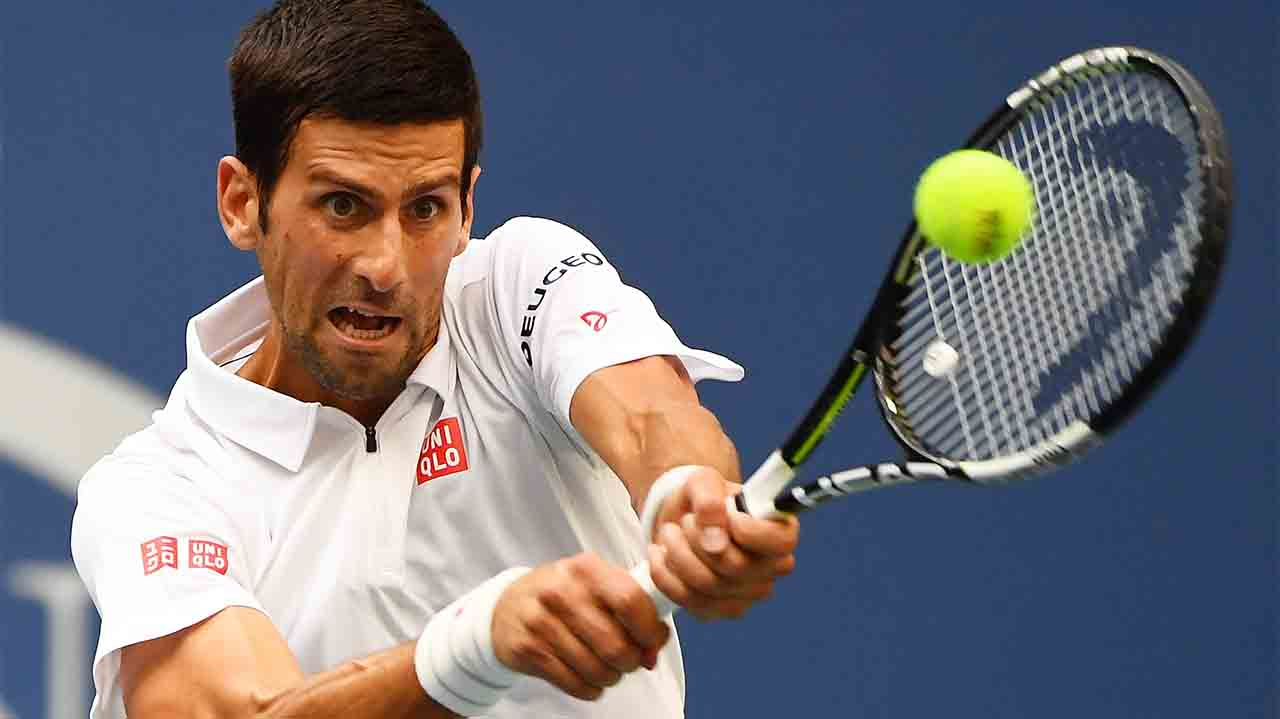 NEW YORK, NY - SEPTEMBER 02: Novak Djokovic of Serbia returns a shot to Mikhail Youzhny of Russia during his third round Men's Singles match on Day Five of the 2016 US Open at the USTA Billie Jean King National Tennis Center on September 2, 2016 in the Flushing neighborhood of the Queens borough of New York City. Alex Goodlett/Getty Images/AFP