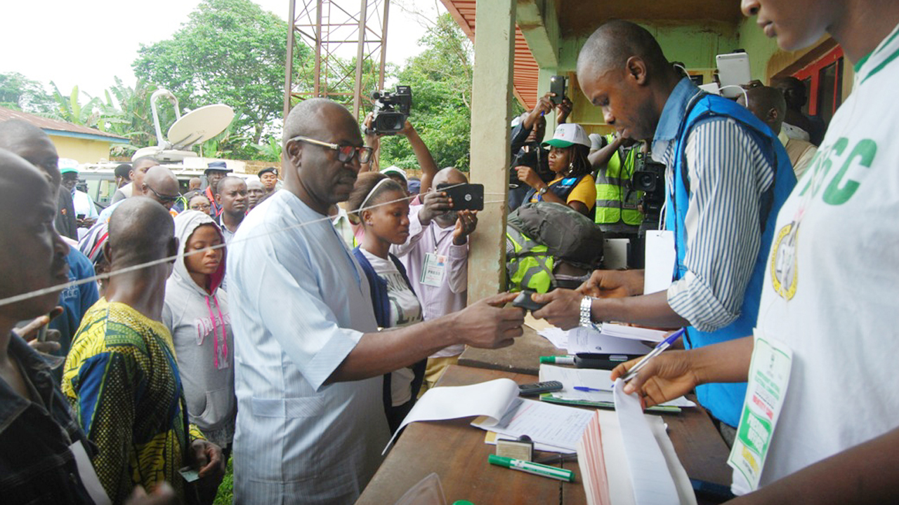 PDP governorship candidate in the Edo State governorship election, Osagie Ize-Iyamu being accredited at Iguododo Primary School during the election on Wednesday. PHOTO: NAN